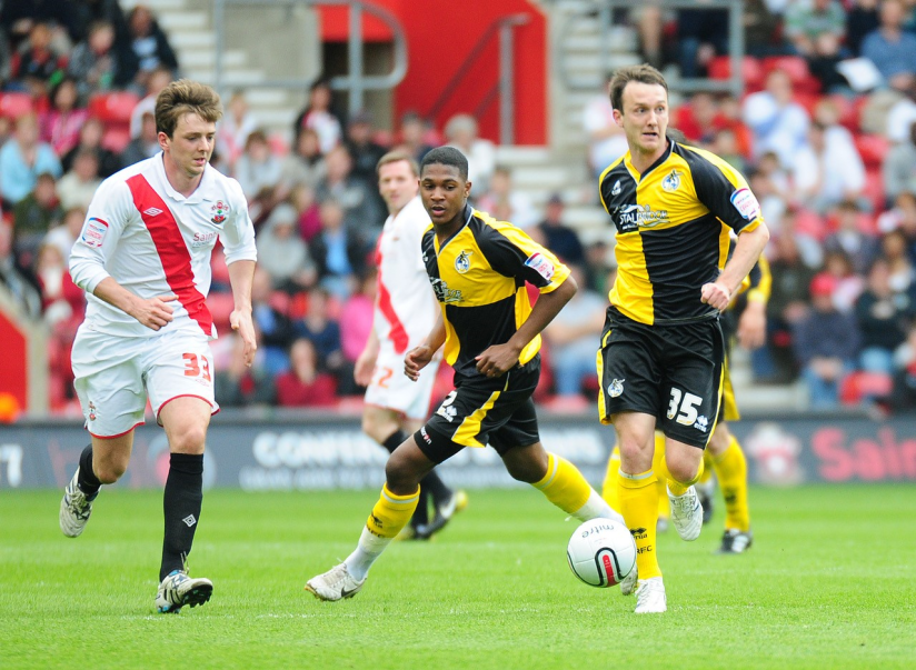 Ellis (centre) pictured on his debut at Southampton - photo credit Neil Brookman