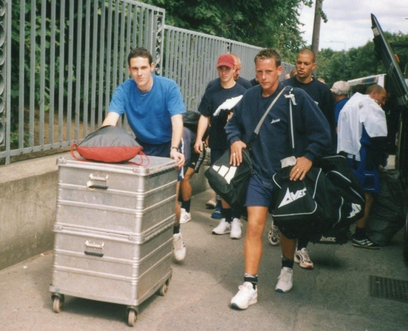Assistant kit manager James Brown and Drew Shore unload the kit, followed closely by Bobby Zamora