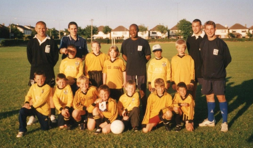 Lee Zabek, Mark Walters, Mike Thought and Simon Bryant, along with assistant kit manager James Brown pictured with the youngsters from Portmarrock FC