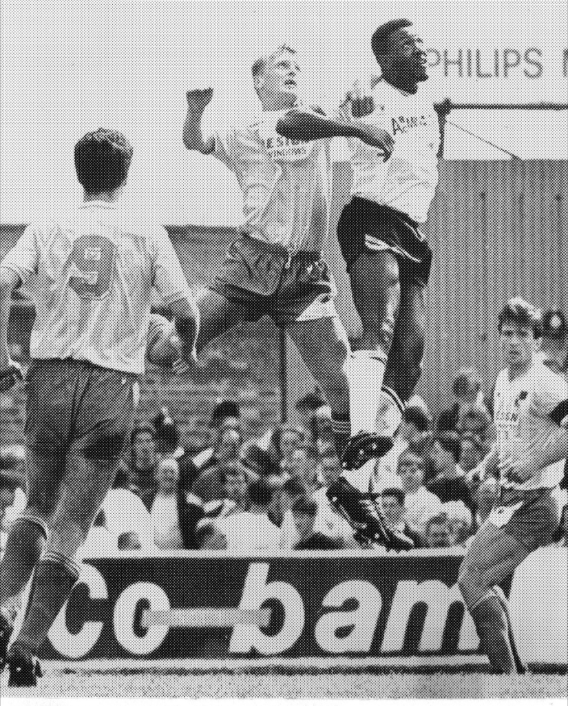 Steve Yates challenges Darren Beckford in the second leg of the 1988-89 play off final at Vale Park