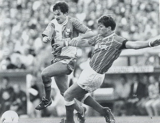 Gary Penrice is challenged by Rob Newman in the derby match at Ashton gate - no credit