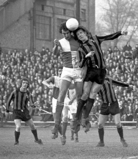 Always my favourite Stuart Taylor photo and almost an iconic image as he challenges Paul Mariner in a game against Plymouth Argyle at Eastville. Photo Credit Alan Marshall
