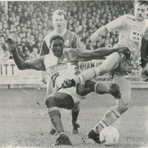 Devon White is challenged by Birmingham City's Ian Atkins