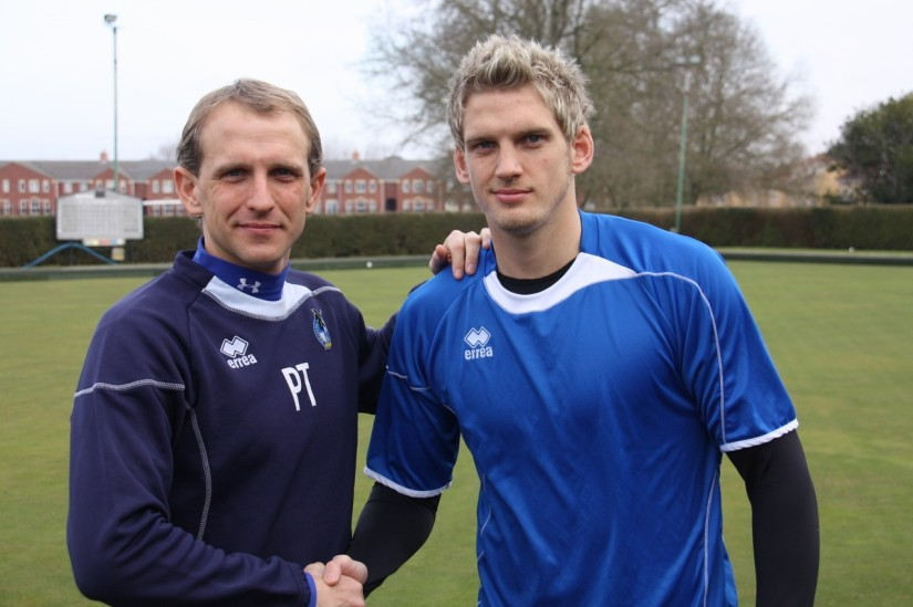 Daniel Jones is welcomed to the club by Paul Trollope. Photo courtesy of Keith Brookman