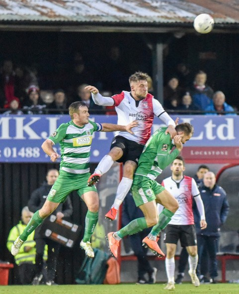 Alex Wall, pictured in action for Woking. Photo courtesy of David Holmes