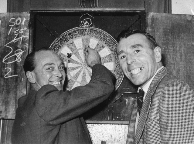 Harry playing darts with Jackie Pitt