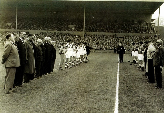 Players of Rovers and City line up prior to the match at Eastville, 24 hours after Harry had passed away