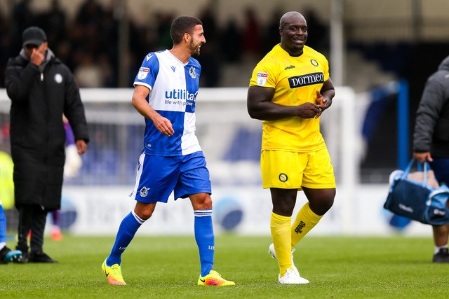 Second of two photos to illustrate the article playing against the gas. Adebayo Akinfenwa pictured at The Memorial Stadium earlier this season. Photo courtesy of JMP UK