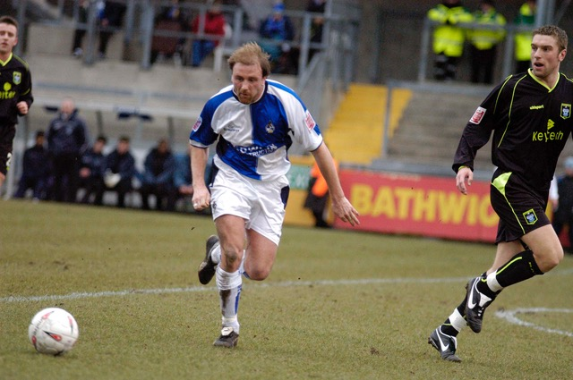 James Hunt pictured in action against Rochdale. The Rochdale player is none other than Rickie Lambert. Photo credit Neil Brookman