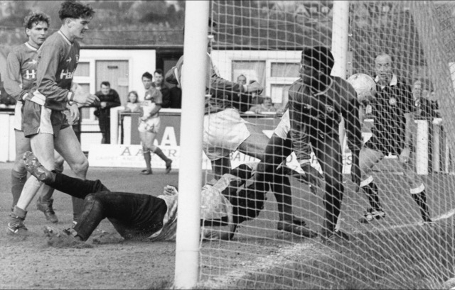 Paul Nixon bundles the ball into the Cardiff City net for a late equaliser