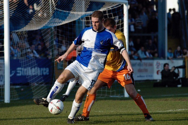 Richard walker shields the ball from a Mansfield player during the 4-4 draw at the Memorial. Photo credit Neil Brookman